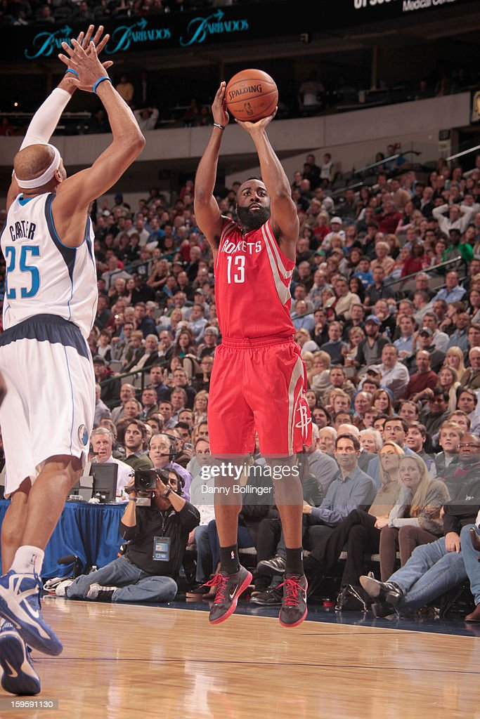 James Harden #13 of the Houston Rockets shoots against Vince Carter #25 of the Dallas Mavericks on January 16, 2013 at the American Airlines Center in Dallas, Texas.