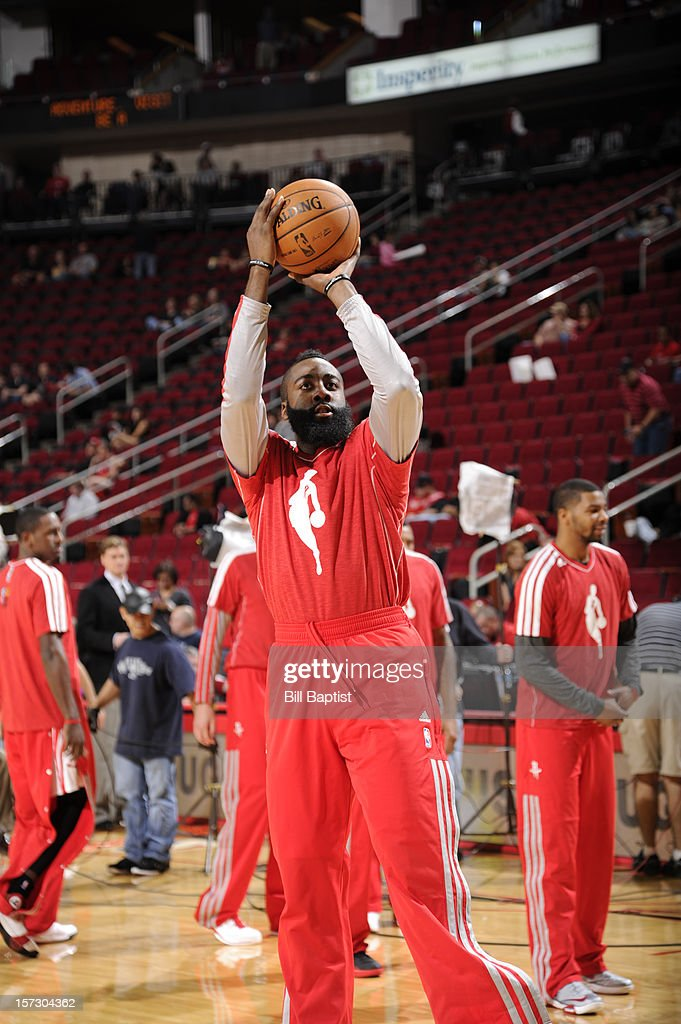 James Harden #13 of the Houston Rockets shoots around before the game against the Utah Jazz supporting a World AIDS Day warm up on December 1, 2012 at the Toyota Center in Houston, Texas.