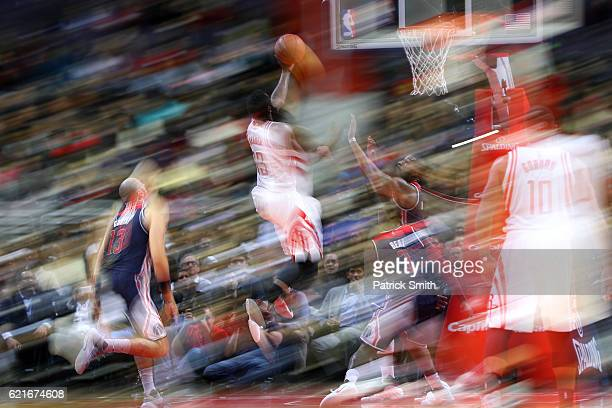 James Harden of the Houston Rockets shoots in front of Bradley Beal of the Washington Wizards during the second half at Verizon Center on November 7...
