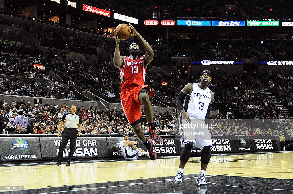 James Harden #13 of the Houston Rockets shoots in front of Stephen Jackson #3 of the San Antonio Spurs during a game at AT&T Center on December 28, 2012 in San Antonio, Texas. San Antonio won the game 122-116.