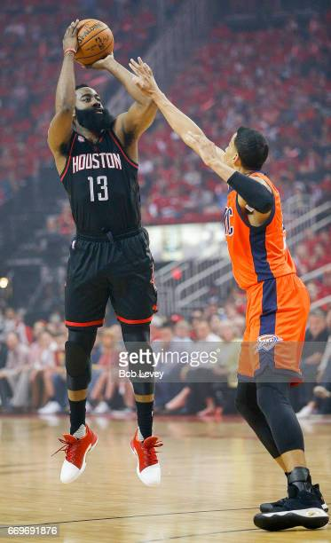 James Harden of the Houston Rockets shoots over Andre Roberson of the Oklahoma City Thunder during Game One of the first round of the Western...