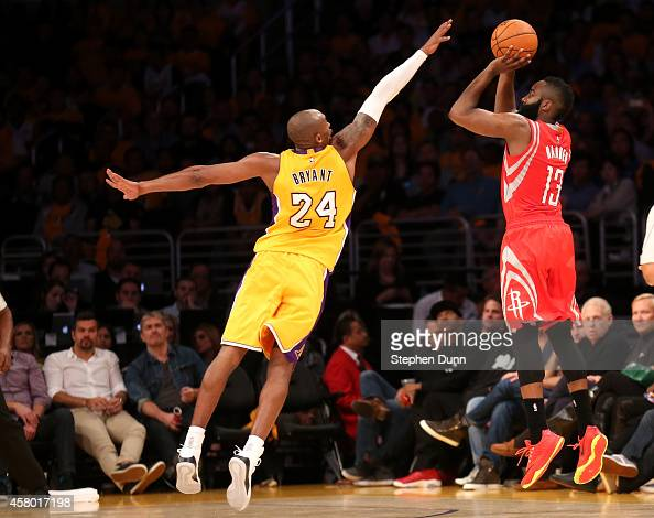 James Harden of the Houston Rockets shoots over Kobe Bryant of the Los Angeles Lakers at Staples Center on October 28 2014 in Los Angeles California...