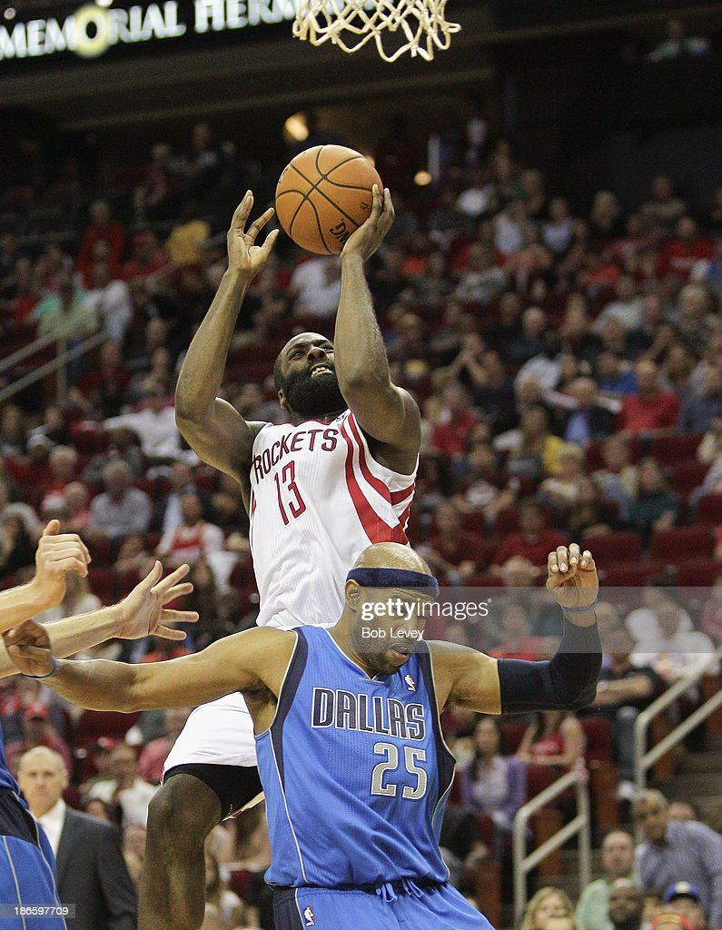 <a gi-track='captionPersonalityLinkClicked' href=/galleries/search?phrase=James+Harden&family=editorial&specificpeople=4215938 ng-click='$event.stopPropagation()'>James Harden</a> #13 of the Houston Rockets shoots over <a gi-track='captionPersonalityLinkClicked' href=/galleries/search?phrase=Vince+Carter&family=editorial&specificpeople=201488 ng-click='$event.stopPropagation()'>Vince Carter</a> #25 of the Dallas Mavericks as he his fouled on the play at Toyota Center on November 1, 2013 in Houston, Texas.