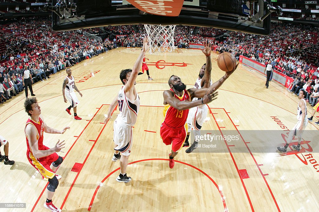 <a gi-track='captionPersonalityLinkClicked' href=/galleries/search?phrase=James+Harden&family=editorial&specificpeople=4215938 ng-click='$event.stopPropagation()'>James Harden</a> #13 of the Houston Rockets shoots the ball against the Atlanta Hawks on December 31, 2012 at the Toyota Center in Houston, Texas.