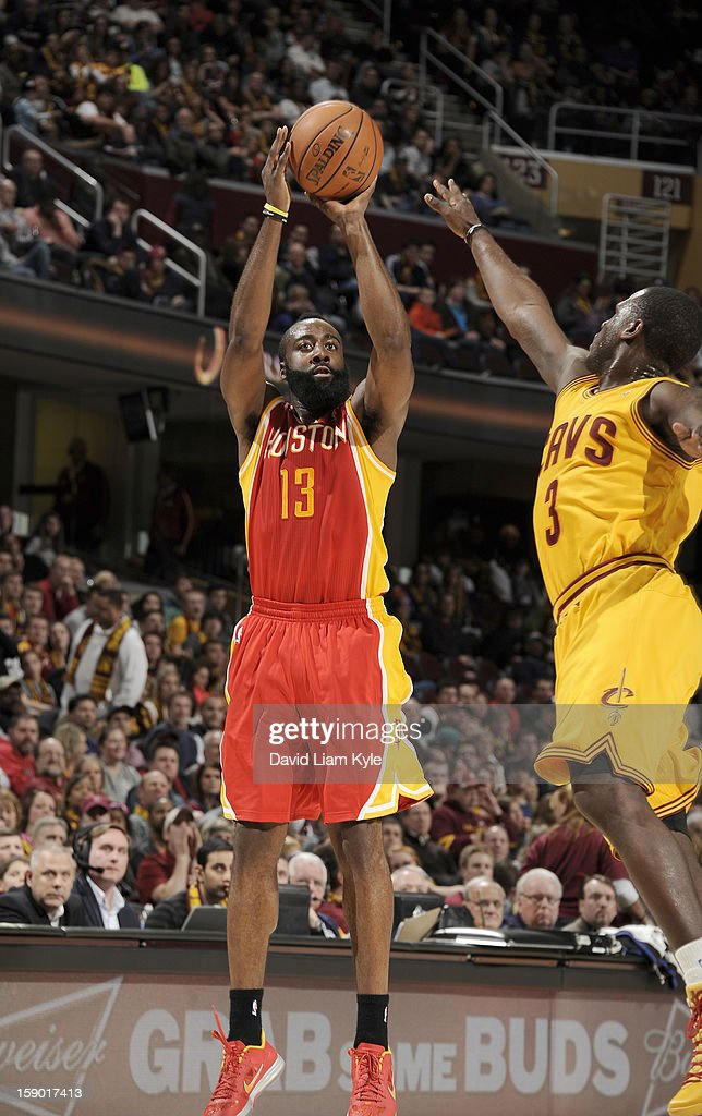 <a gi-track='captionPersonalityLinkClicked' href=/galleries/search?phrase=James+Harden&family=editorial&specificpeople=4215938 ng-click='$event.stopPropagation()'>James Harden</a> #13 of the Houston Rockets shoots the jumper against <a gi-track='captionPersonalityLinkClicked' href=/galleries/search?phrase=Dion+Waiters&family=editorial&specificpeople=6902921 ng-click='$event.stopPropagation()'>Dion Waiters</a> #3 of the Cleveland Cavaliers at The Quicken Loans Arena on January 5, 2013 in Cleveland, Ohio.