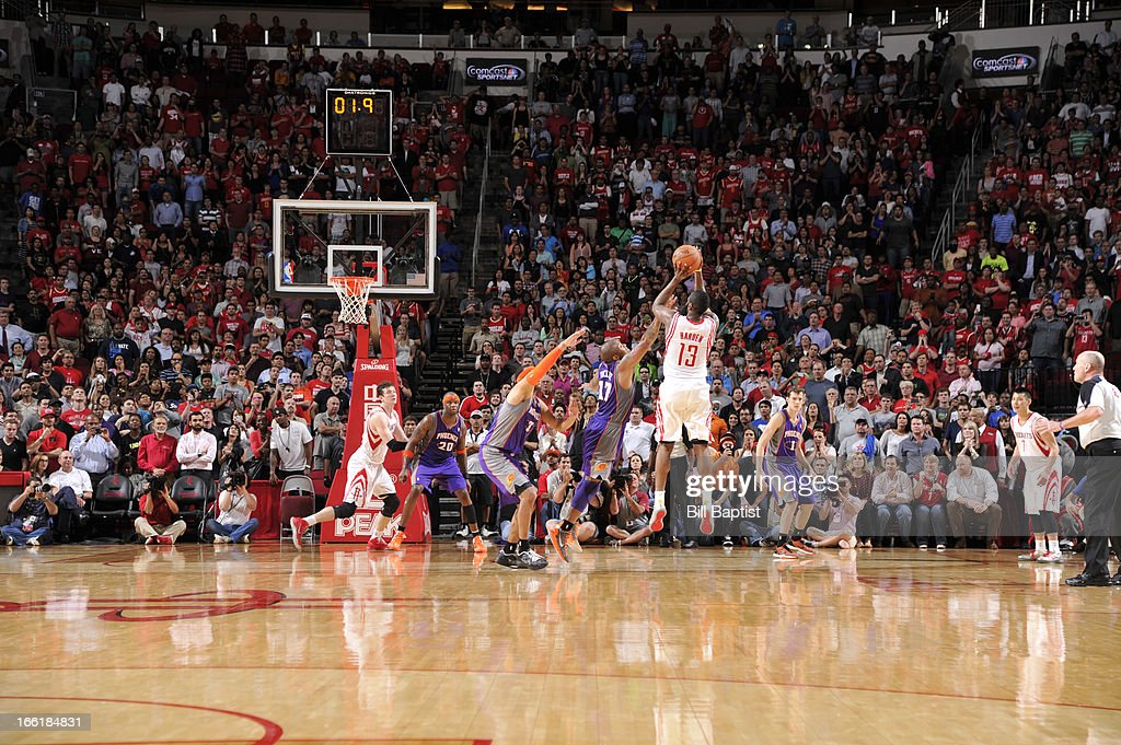 <a gi-track='captionPersonalityLinkClicked' href=/galleries/search?phrase=James+Harden&family=editorial&specificpeople=4215938 ng-click='$event.stopPropagation()'>James Harden</a> #13 of the Houston Rockets shoots the winning three-point shot at the buzzer against the Phoenix Suns on April 9, 2013 at the Toyota Center in Houston, Texas.