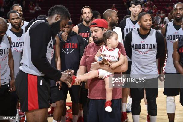 James Harden of the Houston Rockets signs an autograph during the team's annual Fan Fest event on October 7 2017 at the Toyota Center in Houston...