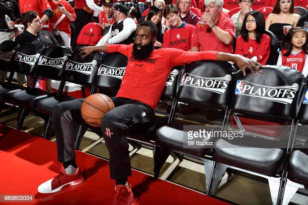 James Harden of the Houston Rockets sits on the bench before the Western Conference Quarterfinals game against the Oklahoma City Thunder during the...
