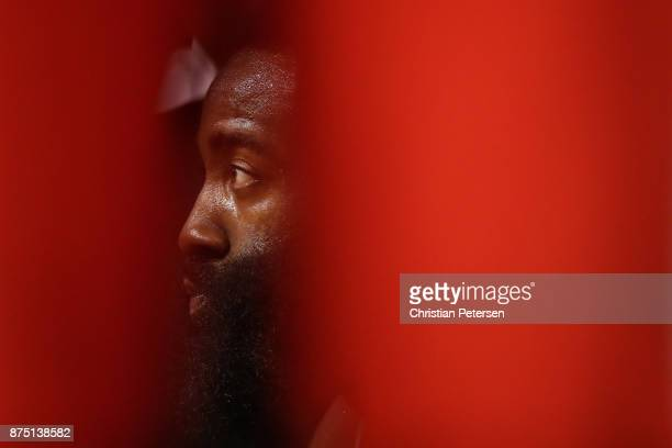 James Harden of the Houston Rockets sits on the bench during the first half of the NBA game against the Phoenix Suns at Talking Stick Resort Arena on...