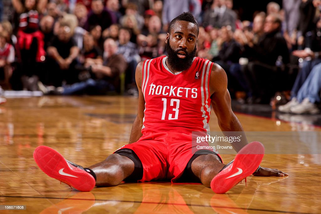 <a gi-track='captionPersonalityLinkClicked' href=/galleries/search?phrase=James+Harden&family=editorial&specificpeople=4215938 ng-click='$event.stopPropagation()'>James Harden</a> #13 of the Houston Rockets sits on the ground after falling during a game against the Portland Trail Blazers on November 16, 2012 at the Rose Garden Arena in Portland, Oregon.