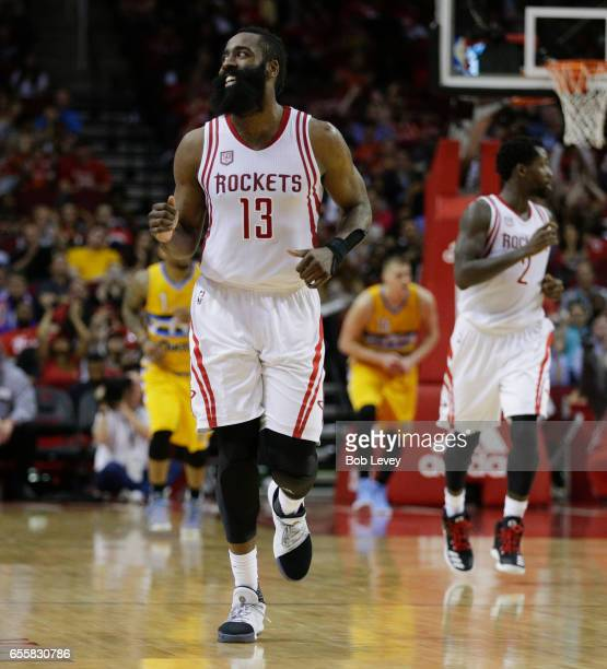 James Harden of the Houston Rockets smiles at the fans after making a threepoint basket during the fourth quarter against the Denver Nuggets at...