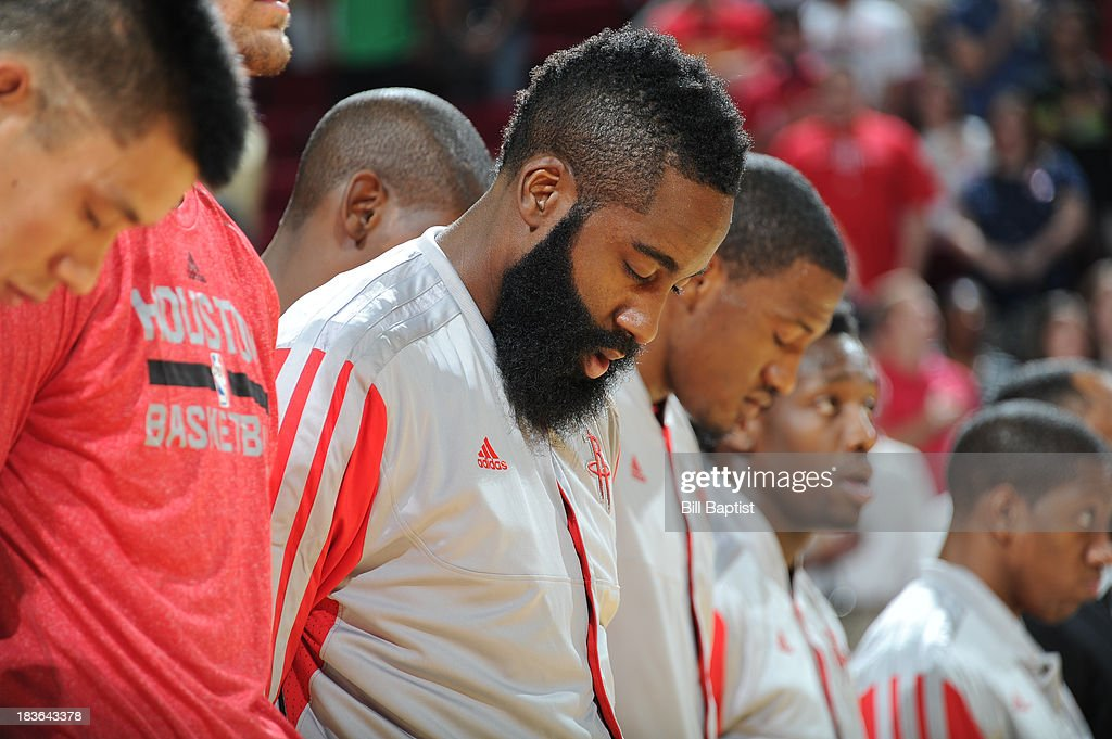 <a gi-track='captionPersonalityLinkClicked' href=/galleries/search?phrase=James+Harden&family=editorial&specificpeople=4215938 ng-click='$event.stopPropagation()'>James Harden</a> #13 of the Houston Rockets stands for the National Anthem before the game against the New Orleans Pelicans before the 2013 NBA pre-season game on October 5, 2013 at the Toyota Center in Houston, Texas.