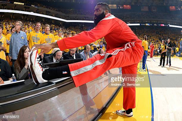 James Harden of the Houston Rockets stretches before a game against the Golden State Warriors in Game Five of the Western Conference Finals during...