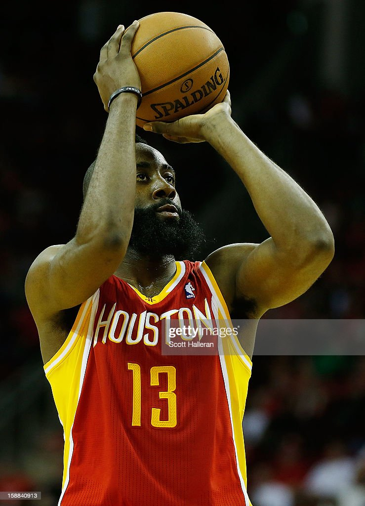 James Harden #13 of the Houston Rockets takes a free throw against the Atlanta Hawks at the Toyota Center on December 31, 2012 in Houston, Texas.