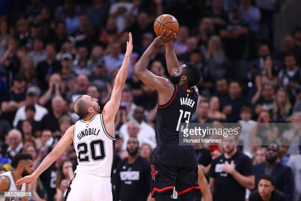 James Harden of the Houston Rockets takes a shot against Manu Ginobili of the San Antonio Spurs during Game Five of the Western Conference SemiFinals...