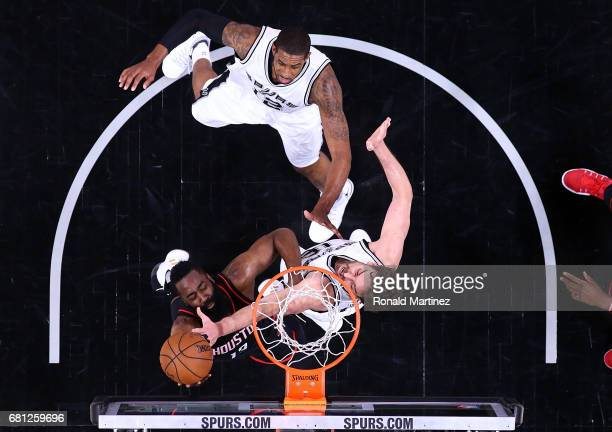 James Harden of the Houston Rockets takes a shot against Pau Gasol of the San Antonio Spurs during Game Five of the Western Conference SemiFinals at...