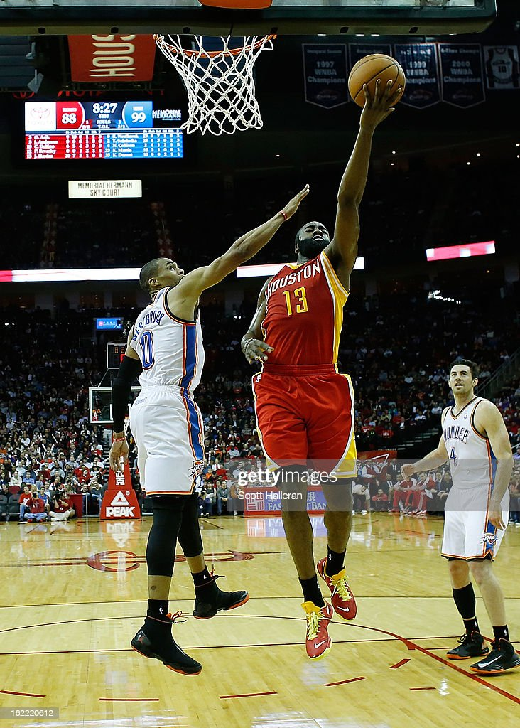 <a gi-track='captionPersonalityLinkClicked' href=/galleries/search?phrase=James+Harden&family=editorial&specificpeople=4215938 ng-click='$event.stopPropagation()'>James Harden</a> #13 of the Houston Rockets takes a shot against <a gi-track='captionPersonalityLinkClicked' href=/galleries/search?phrase=Russell+Westbrook&family=editorial&specificpeople=4044231 ng-click='$event.stopPropagation()'>Russell Westbrook</a> #0 of the Oklahoma City Thunder at Toyota Center on February 20, 2013 in Houston, Texas.