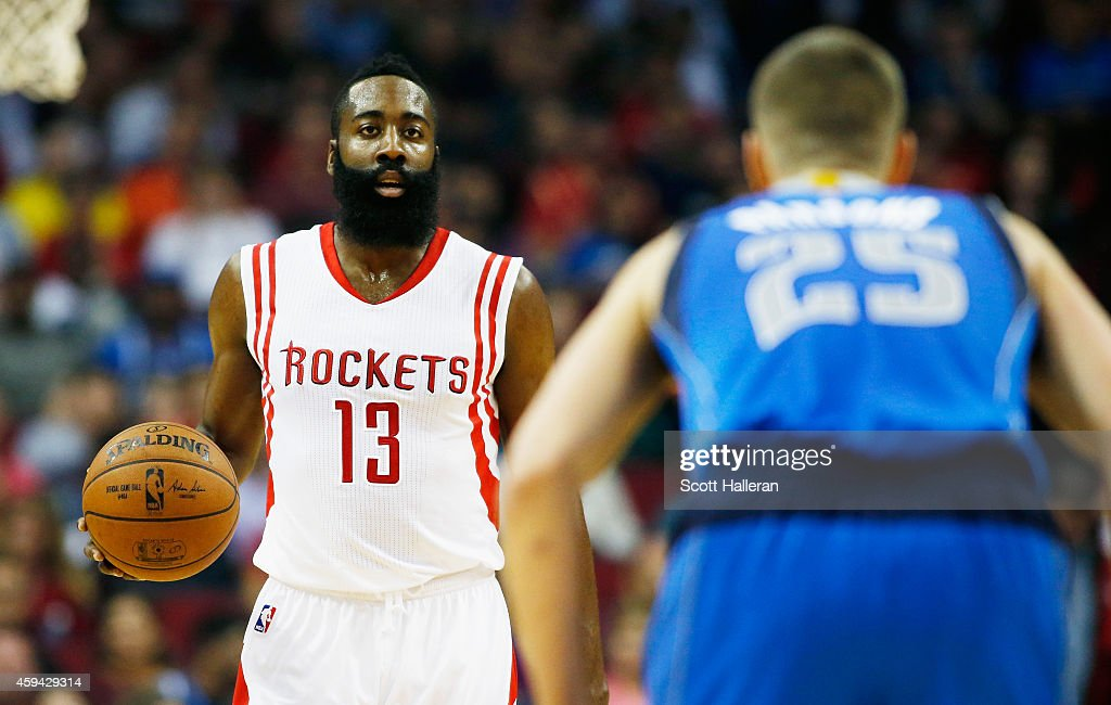 <a gi-track='captionPersonalityLinkClicked' href=/galleries/search?phrase=James+Harden&family=editorial&specificpeople=4215938 ng-click='$event.stopPropagation()'>James Harden</a> #13 of the Houston Rockets takes the ball upcourt towards <a gi-track='captionPersonalityLinkClicked' href=/galleries/search?phrase=Chandler+Parsons&family=editorial&specificpeople=4249869 ng-click='$event.stopPropagation()'>Chandler Parsons</a> #25 of the Dallas Mavericks during their game at the Toyota Center on November 22, 2014 in Houston, Texas.