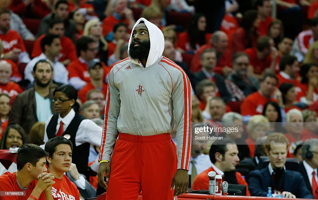 James Harden #13 of the Houston Rockets waits near the bench during the game against the Oklahoma City Thunder in Game Six of the Western Conference Quarterfinals of the 2013 NBA Playoffs at the Toyota Center on May 3, 2013 in Houston, Texas.