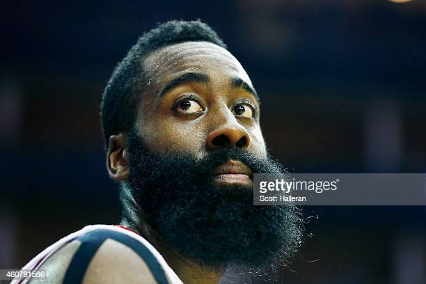 James Harden of the Houston Rockets waits near the bench during their game against the Portland Trail Blazers at the Toyota Center on December 22...