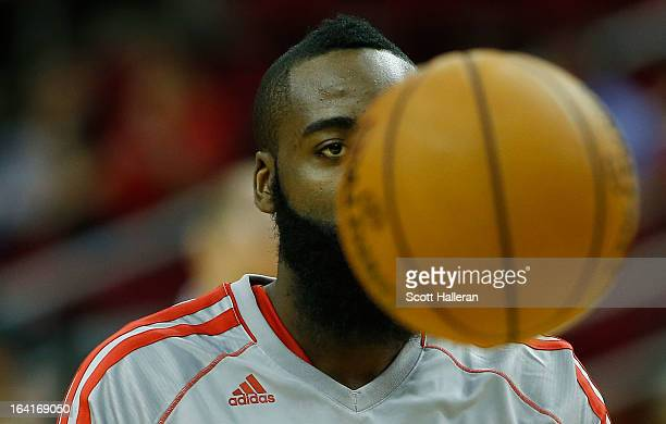 James Harden of the Houston Rockets waits on the court before the game against the Utah Jazz at Toyota Center on March 20 2013 in Houston Texas NOTE...