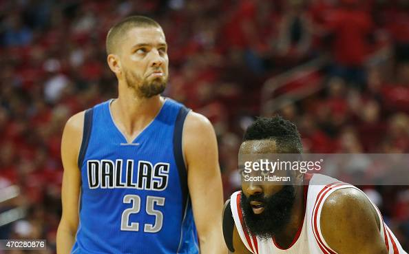 James Harden of the Houston Rockets waits on the court with Chandler Parsons of the Dallas Mavericks during Game One in the Western Conference...