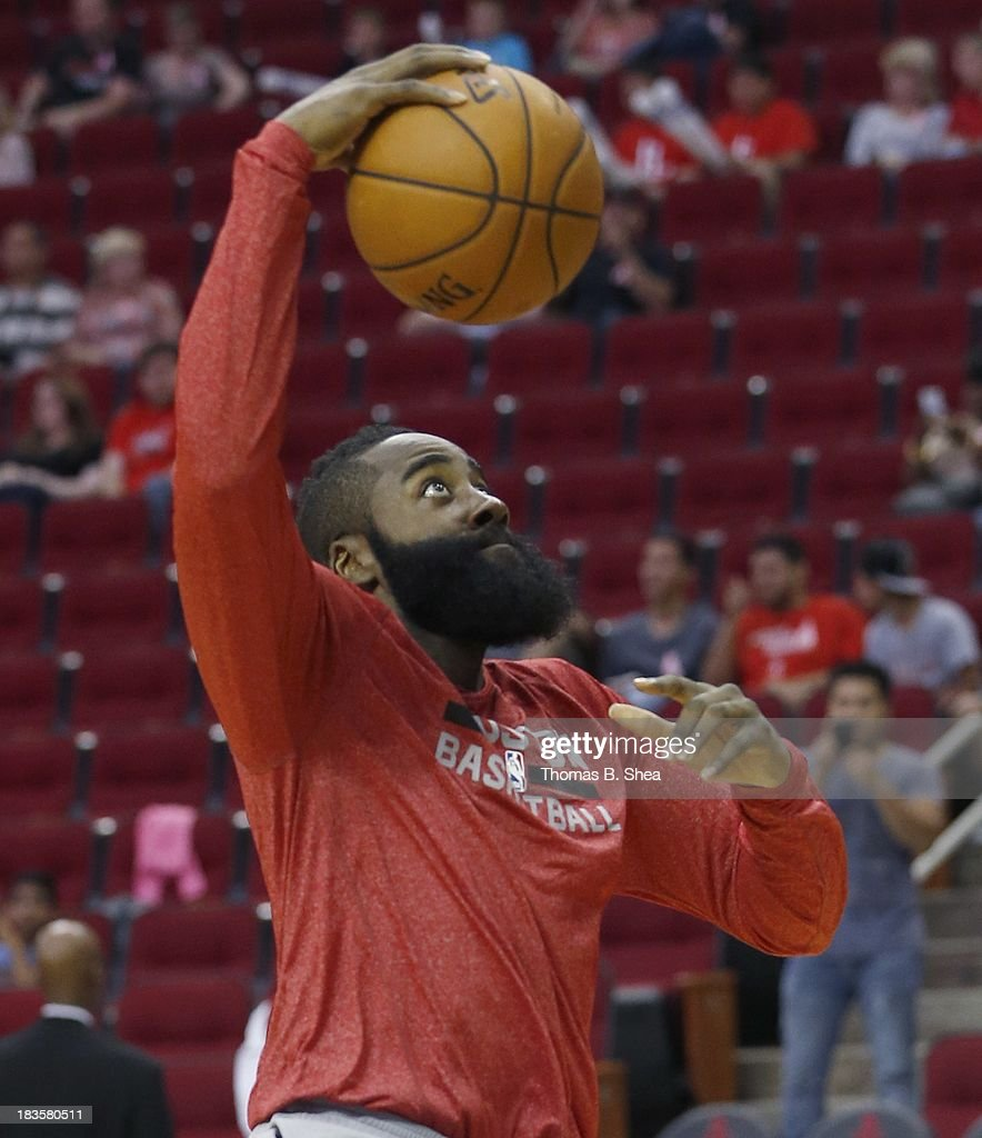 James Harden #13 of the Houston Rockets warms up before playing against the New Orleans Pelicans in a preseason NBA game on October 5, 2013 at Toyota Center in Houston, Texas. The Pelicans won 116 to 115.