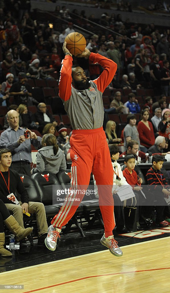 James Harden #13 of the Houston Rockets warms-up before the game against the Chicago Bulls on December 25, 2012 at the United Center in Chicago, Illinois.