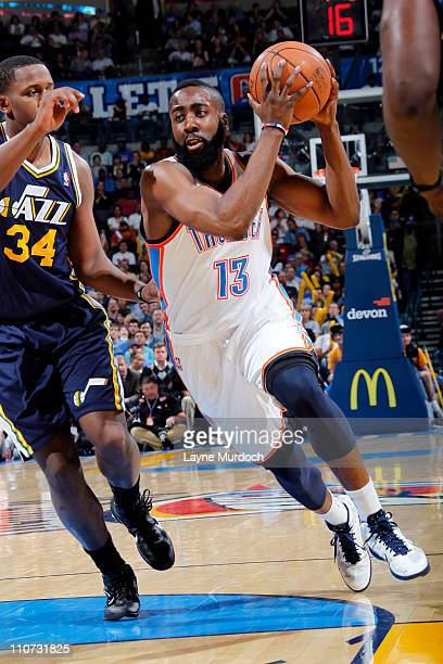 James Harden of the Oklahoma City Thunder drives to the basket against CJ Miles of the Utah Jazz during the game on March 23 2011 at the Oklahoma...