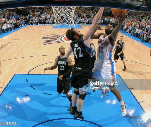 James Harden of the Oklahoma City Thunder drives to the basket against Kevin Love of the Minnesota Timberwolves on March 23 2012 at the Chesapeake...