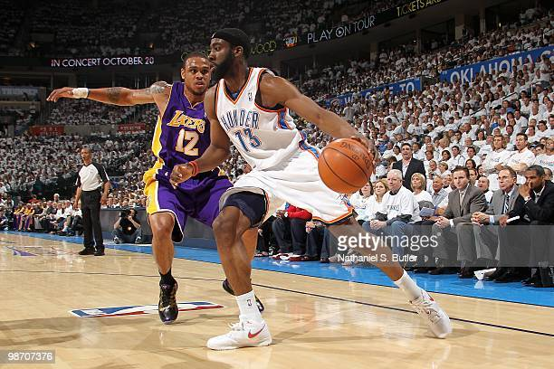 James Harden of the Oklahoma City Thunder drives to the basket past Shannon Brown of the Los Angeles Lakers in Game Four of the Western Conference...