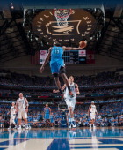 James Harden of the Oklahoma City Thunder goes in for the dunk against the Dallas Mavericks in Game Four of the Western Conference Quarterfinals...