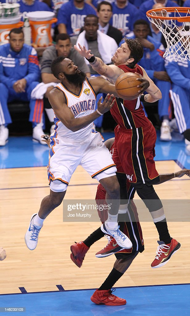 <a gi-track='captionPersonalityLinkClicked' href=/galleries/search?phrase=James+Harden&family=editorial&specificpeople=4215938 ng-click='$event.stopPropagation()'>James Harden</a> #13 of the Oklahoma City Thunder goes to the basket against <a gi-track='captionPersonalityLinkClicked' href=/galleries/search?phrase=Mike+Miller+-+Basketballer&family=editorial&specificpeople=201801 ng-click='$event.stopPropagation()'>Mike Miller</a> #13 of the Miami Heat during Game One of the 2012 NBA Finals between the Miami Heat and the Oklahoma City Thunder at Chesapeake Energy Arena on June 12, 2012 in Oklahoma City, Oklahoma.