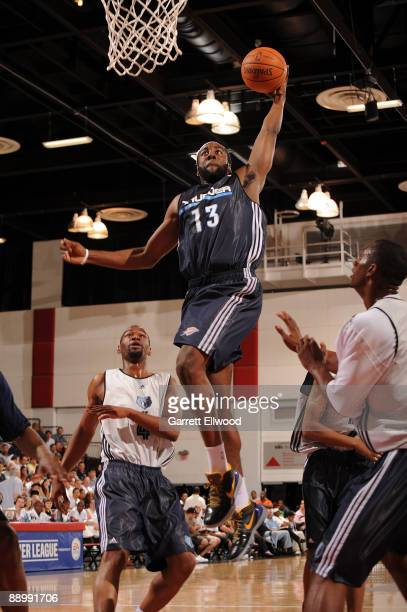 James Harden of the Oklahoma City Thunder goes to the basket against Sam Young of the Memphis Grizzlies during NBA Summer League presented by EA...