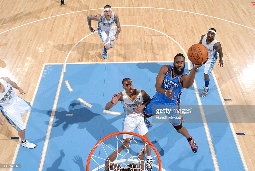 <a gi-track='captionPersonalityLinkClicked' href=/galleries/search?phrase=James+Harden&family=editorial&specificpeople=4215938 ng-click='$event.stopPropagation()'>James Harden</a> #13 of the Oklahoma City Thunder goes to the basket over <a gi-track='captionPersonalityLinkClicked' href=/galleries/search?phrase=Arron+Afflalo&family=editorial&specificpeople=640861 ng-click='$event.stopPropagation()'>Arron Afflalo</a> #6 of the Denver Nuggets on March 15, 2012 at the Pepsi Center in Denver, Colorado.