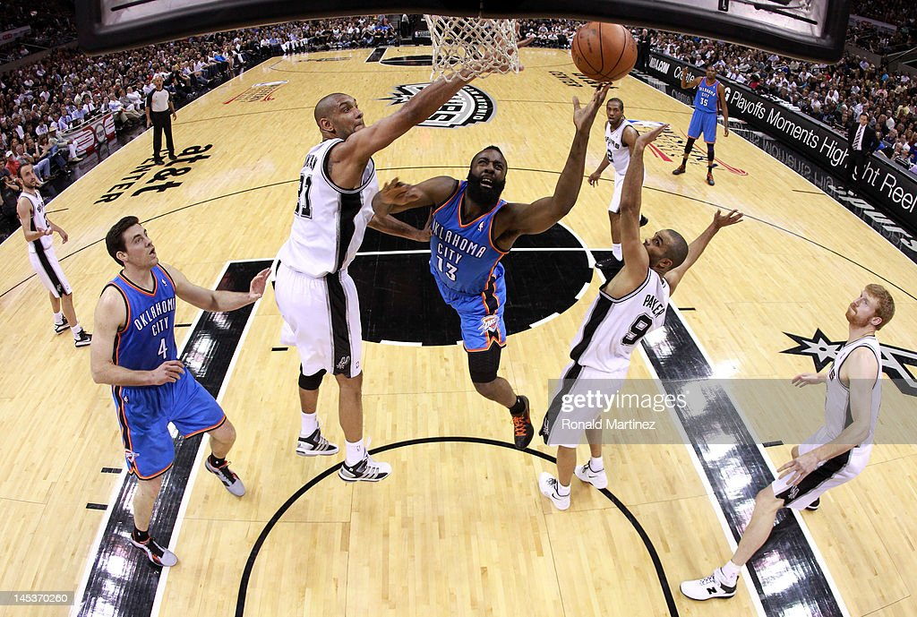 James Harden #13 of the Oklahoma City Thunder goes up for a shot between Tim Duncan #21 and Tony Parker #9 of the San Antonio Spurs in the first half in Game One of the Western Conference Finals of the 2012 NBA Playoffs at AT&T Center on May 27, 2012 in San Antonio, Texas.