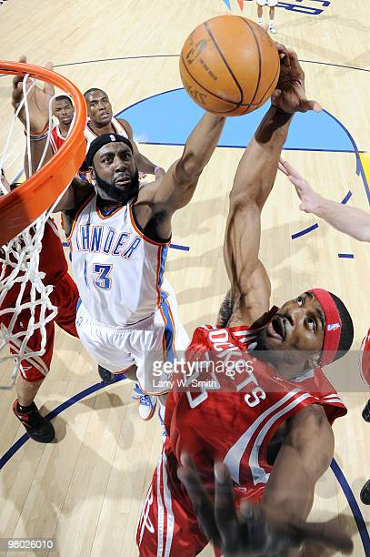 James Harden of the Oklahoma City Thunder grabs a rebound away from Mike Harris of the Houston Rockets during the game at the Ford Center on March 24...