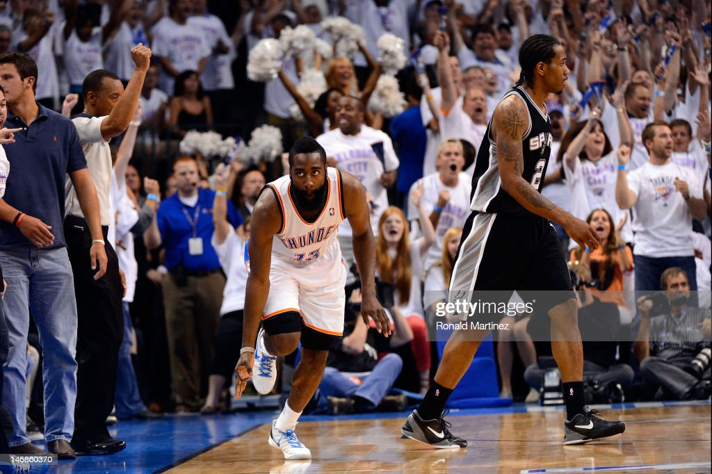 <a gi-track='captionPersonalityLinkClicked' href=/galleries/search?phrase=James+Harden&family=editorial&specificpeople=4215938 ng-click='$event.stopPropagation()'>James Harden</a> #13 of the Oklahoma City Thunder reacts after hitting a three pointer late in the game against the San Antonio Spurs in Game Six of the Western Conference Finals of the 2012 NBA Playoffs at Chesapeake Energy Arena on June 6, 2012 in Oklahoma City, Oklahoma.