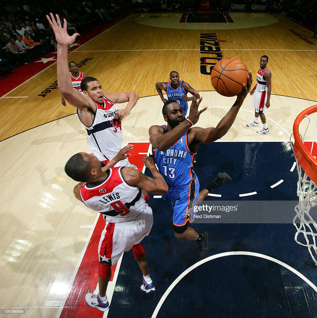 <a gi-track='captionPersonalityLinkClicked' href=/galleries/search?phrase=James+Harden&family=editorial&specificpeople=4215938 ng-click='$event.stopPropagation()'>James Harden</a> #13 of the Oklahoma City Thunder shoots against <a gi-track='captionPersonalityLinkClicked' href=/galleries/search?phrase=Rashard+Lewis&family=editorial&specificpeople=201713 ng-click='$event.stopPropagation()'>Rashard Lewis</a> #9 and <a gi-track='captionPersonalityLinkClicked' href=/galleries/search?phrase=JaVale+McGee&family=editorial&specificpeople=4195625 ng-click='$event.stopPropagation()'>JaVale McGee</a> #34 of the Washington Wizards during the game at the Verizon Center on January 18, 2012 in Washington, DC.