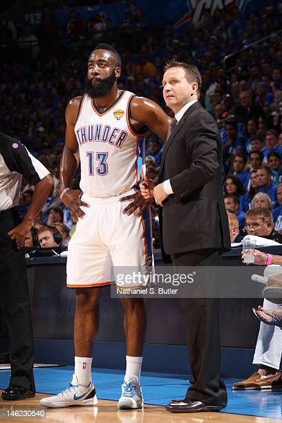 James Harden of the Oklahoma City Thunder with Head Coach Scott Brooks during Game One of the 2012 NBA Finals at Chesapeake Energy Arena on June 12...