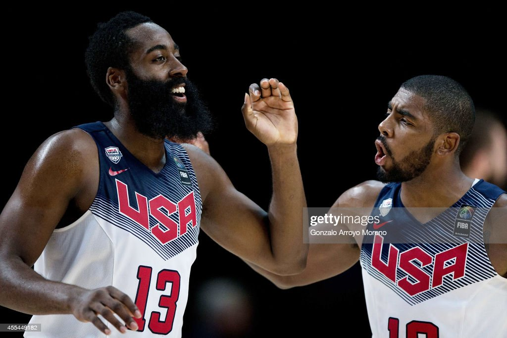 James Harden (L) of the USA celebrates scoring with teammate Kyrie Irving (R) during the 2014 FIBA World Basketball Championship final match between USA and Serbia at Palacio de los Deportes on September 14, 2014 in Madrid, Spain.
