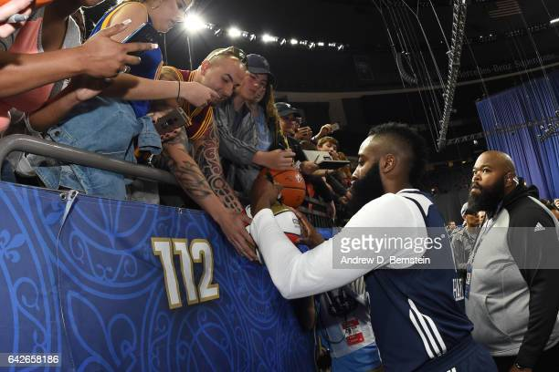 James Harden of the Western Conference AllStar Team signs autographs during the 2017 NBA AllStar Practice as part of 2017 AllStar Weekend at the...