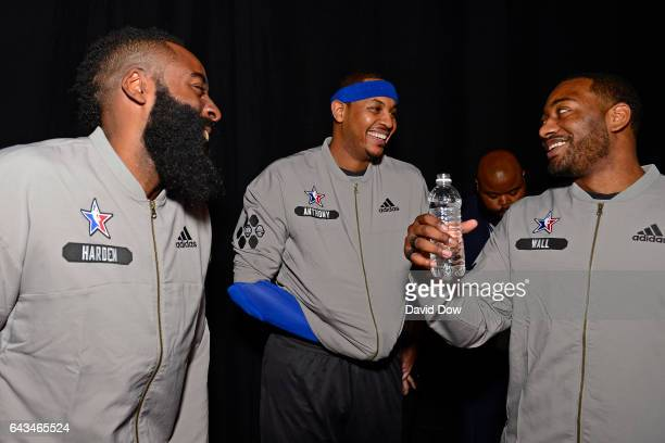 James Harden of the Western Conference AllStar Team talks to Carmelo Anthony and John Wall of the Eastern Conference AllStar Team before the NBA...