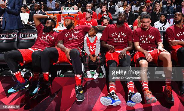 James Harden of the Western Conference AllStars sits on the bench with DeMarcus Cousins Chris Pauls Son Draymond Green and Klay Thompson during the...