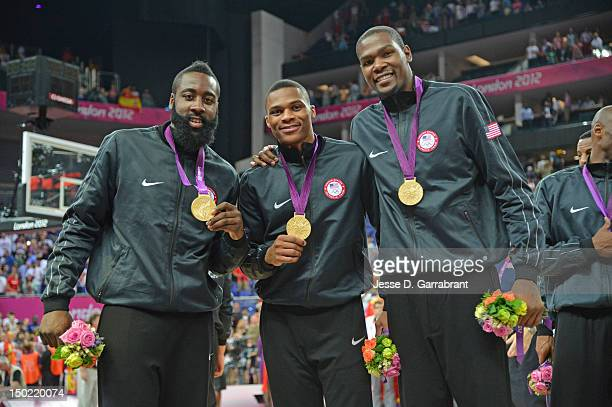 James Harden Russell Westbrook and Kevin Durant of the US Men's Senior National Team pose for a photo after their Men's Gold Medal Basketball Game...