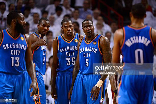 James Harden Serge Ibaka Kevin Durant Kendrick Perkins and Russell Westbrook of the Oklahoma City Thunder stand on court against the Miami Heat in...
