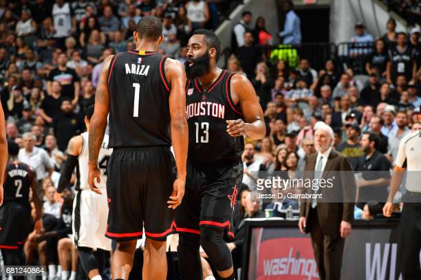 James Harden talks with Trevor Ariza of the Houston Rockets during the game against the San Antonio Spurs during Game Five of the Western Conference...