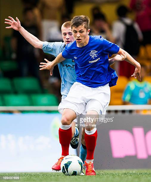 James Hardy of Manchester City and Charlie Telfer of Rangers fight for the ball on day three of the Hong Kong International Soccer Sevens at Hong...