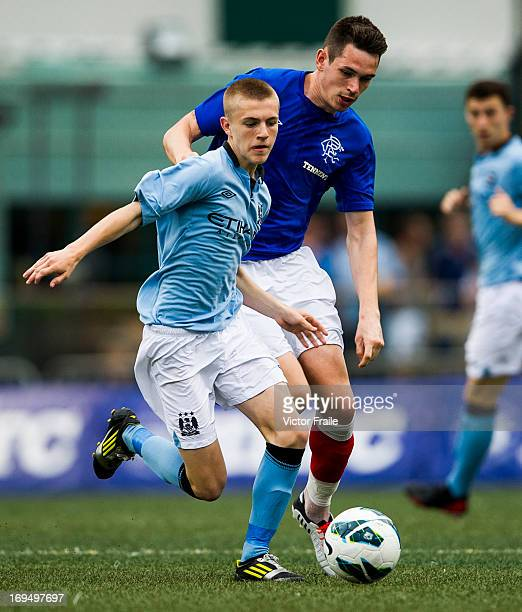 James Hardy of Manchester City and Kyle McAusland of Rangers fight for the ball on day three of the Hong Kong International Soccer Sevens at Hong...