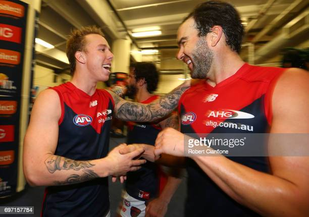 James Harmes and Jordan Lewis of the Demons celebrate after the Demons defeated the Bulldogs during the round 13 AFL match between the Western...
